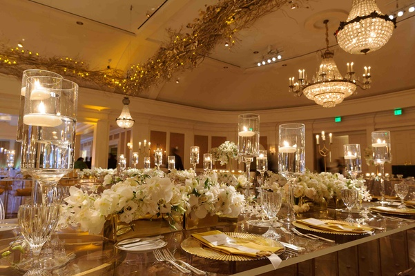 Ballroom wedding with chandeliers and gold branches