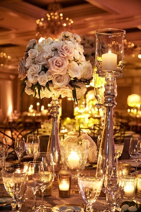 Tall centerpiece arrangement with pink rose ivory rose candlelight in tall candleholders
