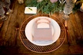 Wedding reception wood table with copper rose gold charger place foil menu card greenery