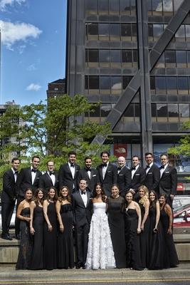 bride in oscar de la renta, groom in j. hilburn, bridesmaids in mismatched black dresses