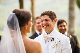 Bride and groom exchange vows at outdoor ceremony in Tuscany