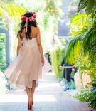 Bride to be in a strapless Oscar de la Renta dress, Louboutin heels, crown of pink roses