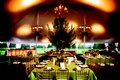 Tented reception with a boxed tree and chandelier