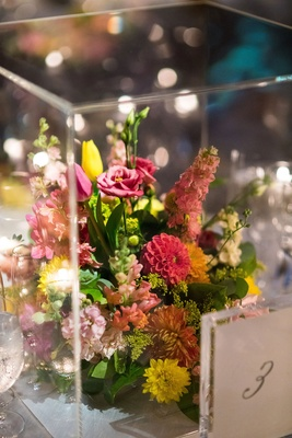 Greenery and pink yellow flowers in lucite box wedding reception modern decor table numbers