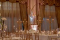 country club wedding reception drapery valance tall gold centerpiece candelabra white flowers candle