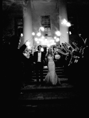 Black and white photo of sparkler wedding exit
