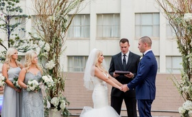 bride in blush by hayley paige, groom in navy tuxedo, friend officiating wedding