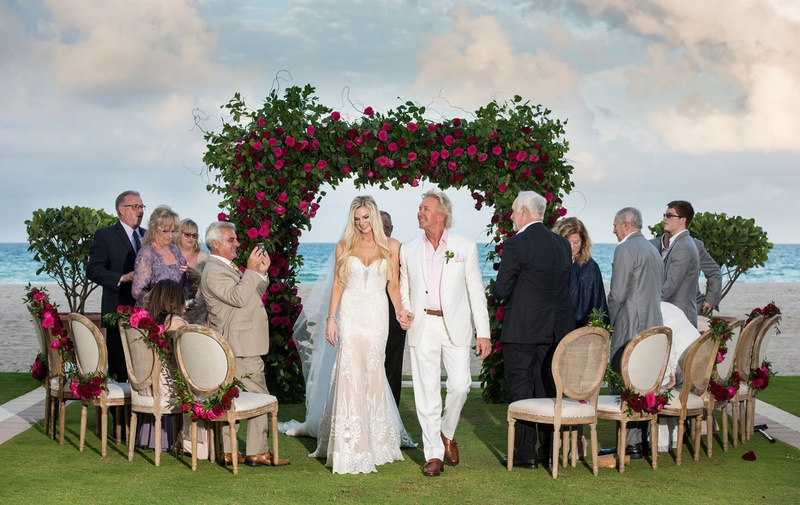 wedding ceremony small guest list acqualina resort and spa green arch pink roses wood chairs round