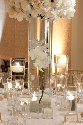 Gold-rimmed glassware and floating candles