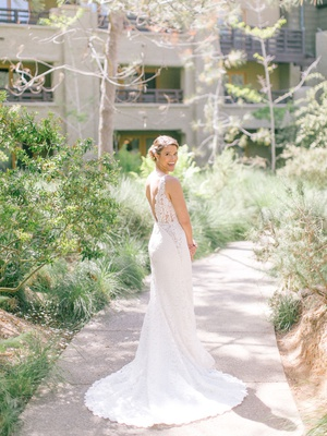bride in lace wedding dress with v neck and v back hair in low bun the lodge at torrey pines wedding