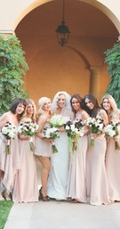 Simone Harouche in a Carolina Herrera gown, bridesmaids in pale pink dresses and Christina Aguilera