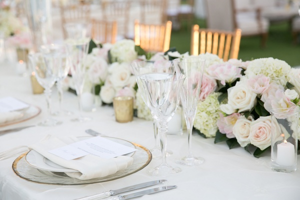 Roses and hydrangeas lining center of table