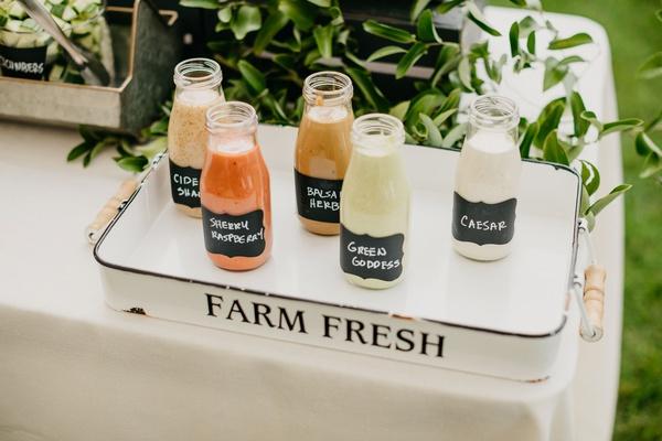 wedding reception salad bar station with homemade dressing caesar, green goddess, balsamic, and more