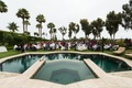 poolside reception surrounded by palm trees