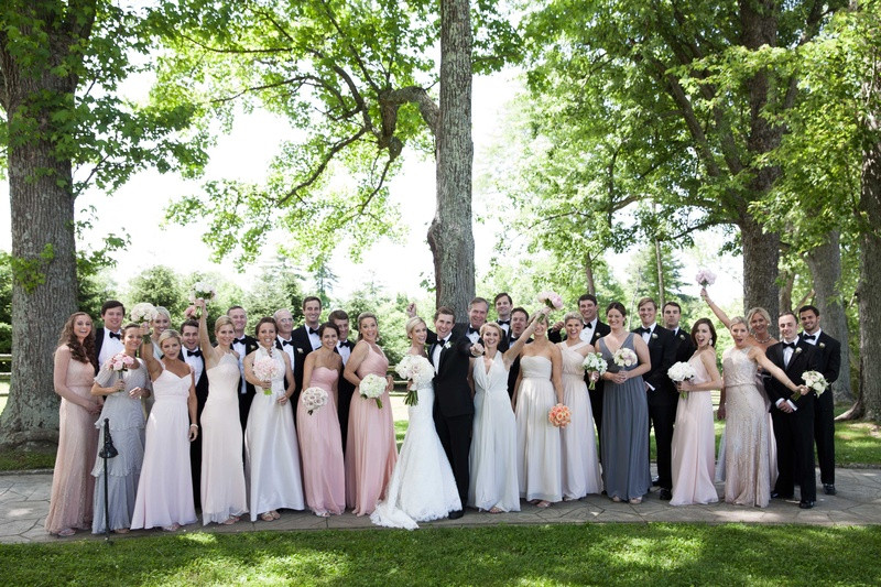 a large and excited bridal party standing outside before the ceremony