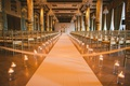 wedding ceremony at the drake hotel chicago white aisle runner hurricane vase candles candlelight
