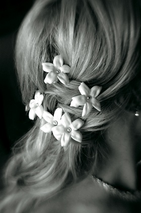 Black and white photo of white flowers in bridal braid