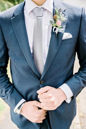 mens blue suit wildflower boutonniere rose greenery blush pink silver tie british english wedding