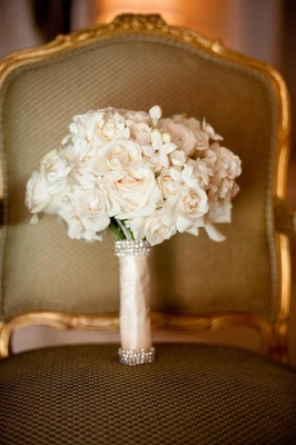 White roses and stephanotis blossoms in crystal wrap