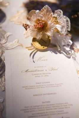 gold and white menu fake flower adornment roman catholic wedding reception food pittsburgh carnegie