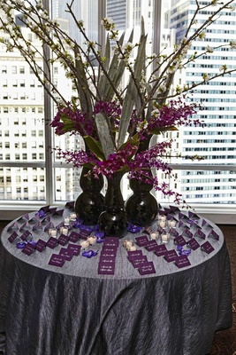 Purple escort card display in front of skyline view