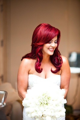 Bride with bright red hair in strapless wedding dress