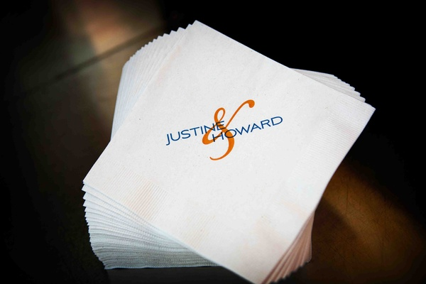 White beverage napkin with blue and orange names