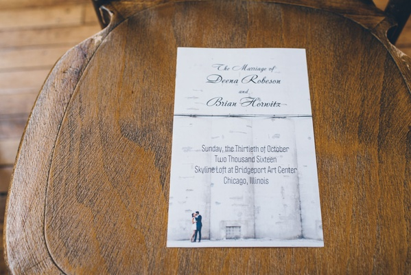 Engagement photo wedding invitation for skyline loft wedding in Chicago on ceremony chair