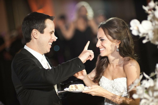 Bride and groom put cake on each other's noses