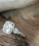 Four prong three stone diamond engagement ring