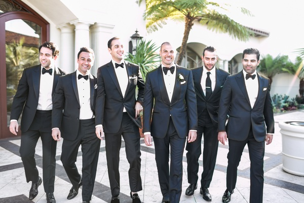 Groom in Tom Ford suit tuxedo bow tie with friends since no groomsmen just best man