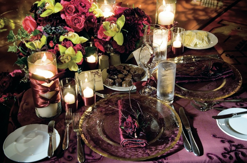 Purple tablecloths with pink and green flowers