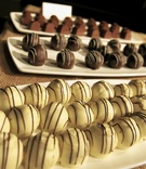 White, milk, and dark chocolates on platters