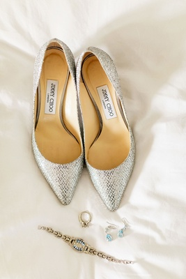 Wedding day jewelry bracelet earrings engagement ring silver metallic jimmy choo pumps pointed toe