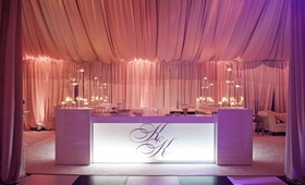 Checkered dance floor and monogrammed bar
