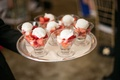 Fresh strawberries and cream in glasses on silver tray