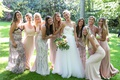 bride in strapless wedding dress pink green bodice pink white cream champagne bridesmaid dresses