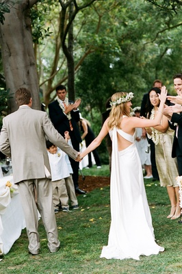 Bride and groom leave green California outdoor ceremony