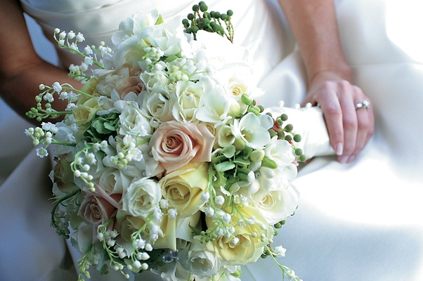 Big bridal bouquet with roses, lily of the valley, and hydrangeas