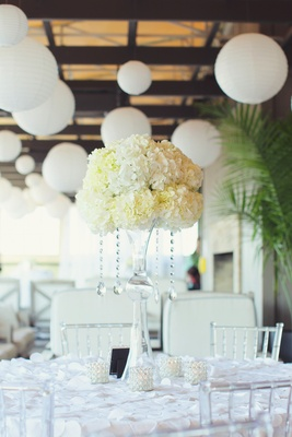 922da3aa71f0b ... Wedding reception table with tall centerpiece of white hydrangeas and  crystal strands ...