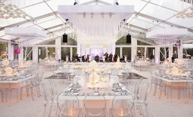 Wedding reception tent clear with white and clear decorations backyard wedding