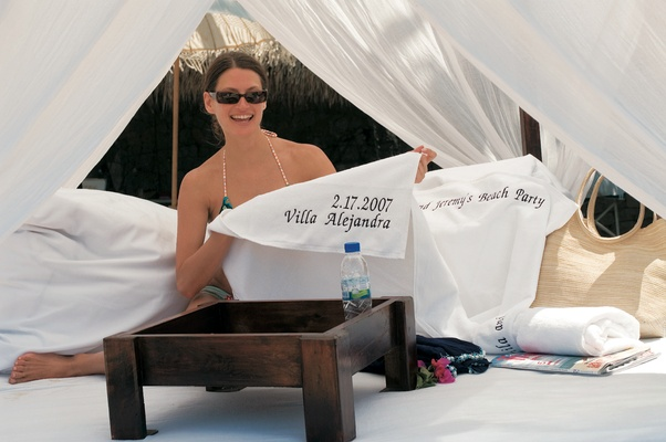 Welcome Bag For Destination Wedding In Mexico Bride Holding Personalized Pool Towel At Party