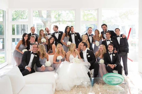 Bride in Vera Wang halter gown and groom with bridesmaids groomsmen in bride's family home
