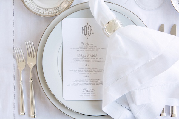 White china at wedding reception with personalized menu card