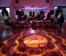 Floral-embellished stage and monogram lighting