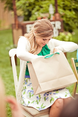 Bride-to-be opens gift outside