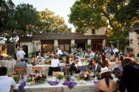 holman ranch wedding rustic courtyard with purple, green, orange