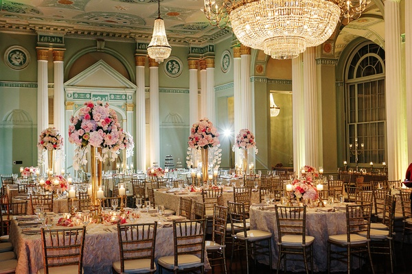 Handpainted ballroom ceilings and crystal chandeliers over reception