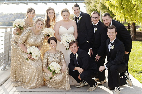 bride in strapless sweetheart watters wedding dress, groom in michael kors tux, bridesmaids in gold