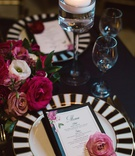 black and white striped charger plates with pink flowers